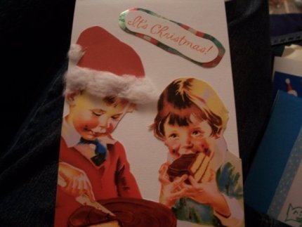 Kids eat cake on a Christmas card